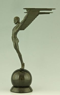 Icarus, an Art Deco Sculpture of a Winged Male Nude Attributed to Schmidt Hofer | From a unique collection of antique and modern sculptures at https://www.1stdibs.com/furniture/more-furniture-collectibles/sculptures/