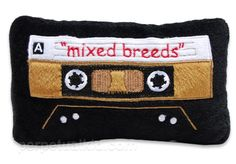 The perfect stocking stuffer for your hipster puppy - Mixed Breeds Cassette Tape Dog Toy.