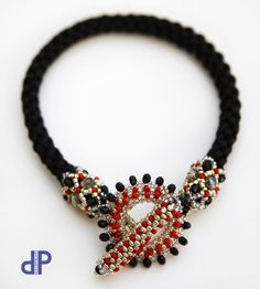 DolcePerlato: Bracelets Kumihimo Great use of kumihimo to showcase the clasp. Love the beaded endcaps.