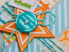 baker's twine and a button on chipboard