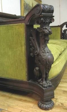 19th c. American Victorian R. J. Horner sofa, with carved gargoyles for support columns.