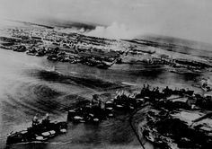 Captured Japanese photograph taken during the December 7, 1941, attack on Pearl Harbor. In the distance, the smoke rises from Hickam Field. 80-G-30550.