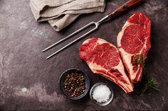 Heart shape Raw fresh meat Ribeye Steak with rosemary, pepper and salt on stone…