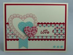 This handmade Happy Valentines Day card features an ivory base that was layered with red cardstock and designer print paper. The smallest