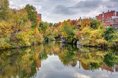 calm Magog river in the heart of Sherbrooke city, Eastern townships, Quebec, Canada in Autumn