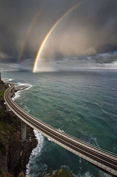 Sea Cliff Bridge with Rainbow by David Wimble on .Sea Cliff Bridge in South Coast, Sea Cliff Bridge, Beautiful World, Beautiful Places, Wonderful Places, Beautiful Scenery, Amazing Things, Amazing Places, Jolie Photo, Amazing Nature