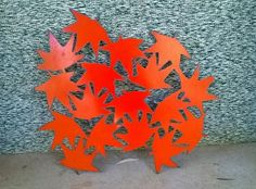 Plasma cut autumn leaves I cut from a metal drum lid.