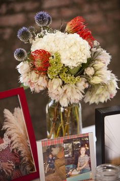 Beautiful table arrangement with personal photos.