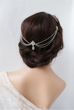 Vintage 1920's wedding hairstyle with chain hairpiece worn at the back of the head. www.devlinbridalcouture.co.uk. We stock a wonderful selection of designer wedding dresses and run a closed door policy to provide you with the ultimate shopping experience.Find your dream dress here with us. xx
