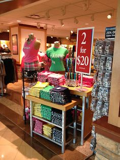 """Great price point signage for these bright tees at the Madison, Wisconsin airport.  Bling key chains and lanyards and the colorful """"Ink'd SkullCandy"""" earbuds on the adjacent rack complete the color story."""