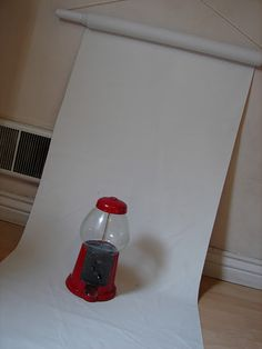 use an old wrapping paper roll to drape fabric for taking pictures..