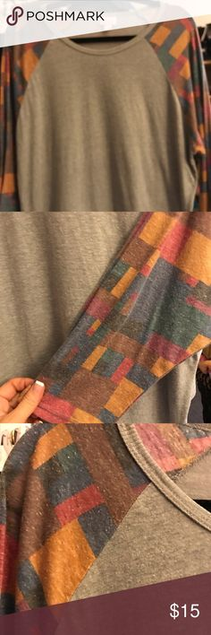LULAROE RANDY 2XL GREY LEGGINGS SOFT BODY COLORFUL 🔥🔥🔥🔥SUPER SOFT LULAROE RANDY WITH COLORFUL BLOCK SLEEVES. GREY BODY IS SLIGHTLY HEATHERED SLEEVES HSBE GREAT COLOR COMBINATIONS.💋💋PRICE FIRM NO LOWBALLS💋💋 LuLaRoe Tops Tunics