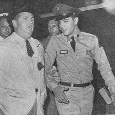 The Col. escorts Elvis to his first press interview, 1958