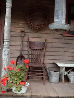 old watering cans | Old chair, watering can and shovel on front porch. by amalia
