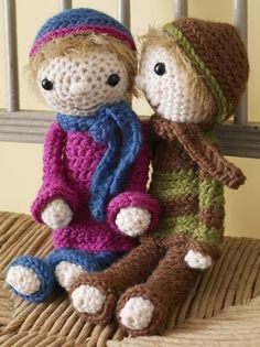 """Shelly Girl Doll, free from Lion Brand yarn.  Bryan, on the left, can also be found by search """"amigurumi bryan doll""""."""