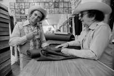 Circa 1970s, Los Angeles, CA– Merle Haggard choosing fabric for a new Nudie suit. –Image by © Jeff Albertson