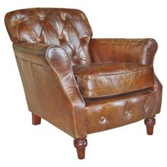 With its beautifully distressed leather upholstery, button tufted detailing and hardwood frame, this classic armchair brings a touch of elegance to any schem...