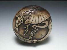 Netsuke with a design of a rain dragon and umbrella - Atsuto Fujii