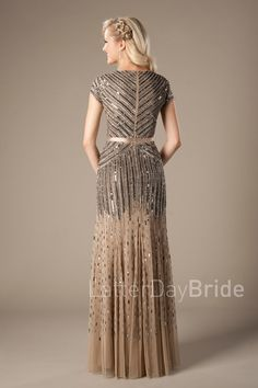 This fabulous modest prom gown features geometric beaded lines crisscrossing down the bodice and cascading into the skirt, finished with tapering beadwork through the chiffon overlay. *Shown in Gold Front neckline is 7 Modest Formal Dresses, Stylish Dresses, Prom Dresses, Sequin Dress With Sleeves, Dresses With Sleeves, Temple Dress, Gold Fronts, Gold Bridesmaid Dresses, Elegant Outfit