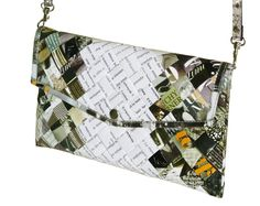 This minimalist thin clutch purse in an envelop shape is made using office document paper at the center part of the purse, and magazine paper in black & white colors at its sides. Folded into strips, laminated and woven tightly.  Comes with a detachable and adjustable strap. Using a clip button for latching. Polyester fabric used for the lining. This purse has no inner pockets  It is available in two different sizes:  Small clutch: Dimensions in inches: 9 long, 5.5 tall, 1 thick (when stu...