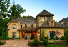 This charming home may be fairly new and big, but it was designed to have the warmth and patina of an old French country cottage. I love the details that Barnes Vanze Architects put into it, from b...