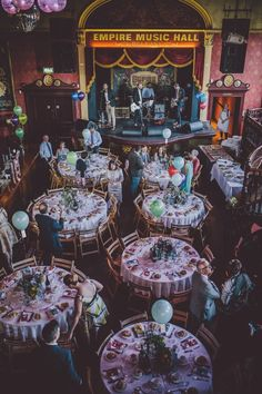 Vintage rock n roll reception with round tables | Image by Ten21 Photography