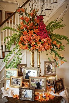 Idea for reception, using parents and grandparents wedding photos and a different flower arrangement - but like the set up