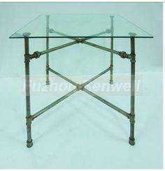 """Have 52"""" round, beveled glass table top, need base.  Thinking DIY, with pipes.  Will keep the table from taking over the room completely!"""