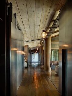 Incredible industrial sliding doors and plank ceiling!