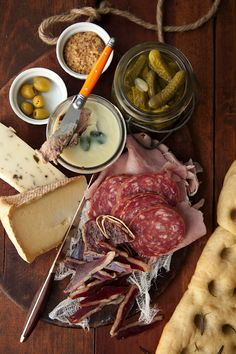 Resultado de imagem para A variety of cured meats and pâtés accompanied by pickles, olives, and mostarda, round out our charcuterie board Antipasto, Charcuterie And Cheese Board, Charcuterie Plate, Cheese Boards, Easy Meals For One, Meat Platter, Cheese Party, Meat And Cheese, Bratwurst
