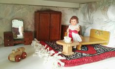 My doll's house is a GeeBee DH9 made between 1964 and 1966. My doll's house bedroom furniture is by A E Twiggs.