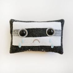 """My son found a box of old memorbilia and pulled out cassettes: """"What are these?"""". Gosh, how to explain the legacy of the """"mixed tape""""? It took hours and hours to compile one track by track. No drag and drop and bingo... a playlist! Then I found this on Etsy - the """"Sad crying Emo Mixtape"""" pillow made by Nellie Le (maybe Emo mixtape mourns his demise?).   For left-field, gift-worthy things to make you giggle , check out bynelliele 's store on Etsy."""