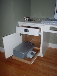 Great storage idea for printer. I like the idea of the pull-out drawer.