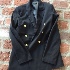 Black blazer with gold buttons 67% polyester 31% viscose 2% spandex jacket. Falls below bottom and flows nicely.  3 gold buttons on each side for show only. Blaque Label Jackets & Coats Blazers