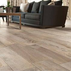 6 x 24 Tumbleweed Porcelain Tile (Lowes #155467)...apparently looks like real wood...if it does it would be great for wet areas like the kitchen or bathrooms...will need to check out! About $3.48/sqft