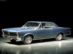 1965 Pontiac GTO...My husband owned a poppy red GTQ. Motor Trend magazine's car of the year!!! Wish we still owned it!!!