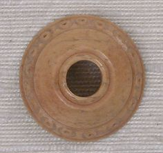Whorl.   Date: 9th–10th century Geography: Iran, Nishapur Medium: Bone; incised and inlaid with paint Dimensions: H. 1/4 in. (0.7 cm) Diam. 1 1/16 in. (2.7 cm)