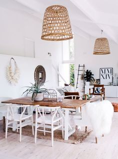 You know how I love me some fresh white walls, warm, natural materials, and a curated, global vibe… So you know that I loved this room from the second I saw it! It's a great example of mixing woods a