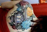 back clock tattoo