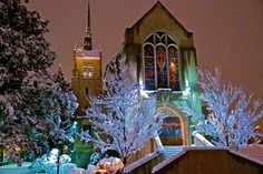 A church, blanketed in snow and light on the banks of the Truckee River