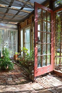 For a screened in patio, or greenhouse.  Red door, brick floor, potted plants...weathered look.