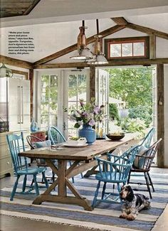Love the rustic wood table with painted chairs