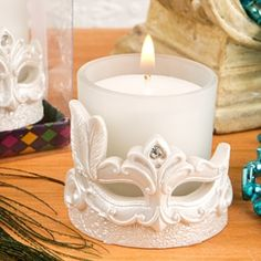 Mardi Gras Masked Theme Candle Votive- Bring the mystery, allure and vibrancy of the Mardi Gras into your next event with a stunning candle votive mask! Enchant your guests with a wild and romantic ambiance at your next event. This stunning gift will Sweet 16 Masquerade, Masquerade Ball Party, Masquerade Theme, Masquerade Wedding, Candle Wedding Favors, Candle Favors, Wedding Party Favors, Votive Candles, Glass Votive