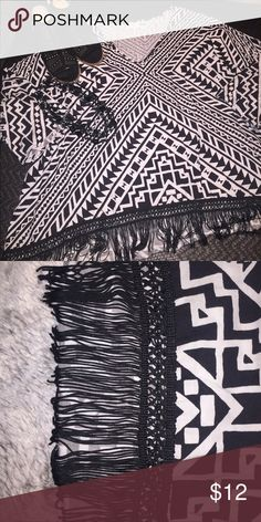 Black & White Aztec Fringed Top Black and white top in Aztec print and fringes bottom. Light weight and very comfortable. Great condition - worn a couple times. Sz. 26/28 Cato Tops Blouses