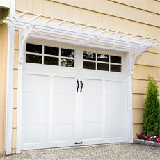 A garage pergola can add a bit of flair to an otherwise utilitarian part of your home's exterior. Want added durability? Use exterior trim (like Trex Trim) in place of pressure-treated lumber.