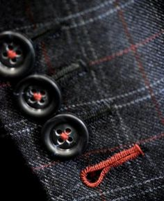 An example of our hand sewn buttonholes.  This jacket was built for a client in mid 2011.  In this instance he chose to use a contrast thread on the last cuff buttonhole as well the thread used to attach the buttons.  A unique and playful look.  With custom you really can do whatever you want!  www.BeckettRobb.com