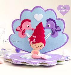 PDF felt pattern quiet soft book Sea shell with little mermaid, seahorses, dolphin, octopus and seastar Felt Crafts Diy, Felt Diy, Mary Kay, Felt Doll Patterns, Felt Banner, Felt Quiet Books, Book Quilt, Needle Felted Animals, Soft Dolls