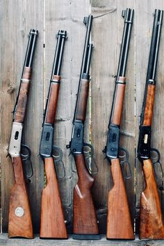 Winchester model 1894 trappers on the left} and lever action rifles.