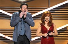 Hosts Blake Shelton (L) and Reba McEntire speak onstage at the 47th Annual Academy Of Country Music Awards held at the MGM Grand Garden Arena on April 1, 2012 in Las Vegas, Nevada.