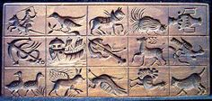 Realistic animals on antique springerle board
